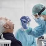 Take a nasal swab sample